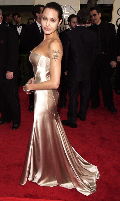 A curvier Angelina Jolie oozed sex appeal in a metallic Versace gown in 2001. (Photo by Steve Granitz/WireImage)