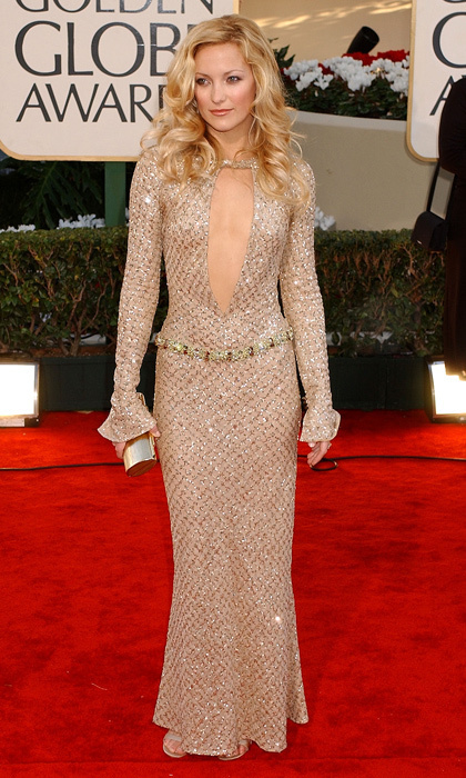 "Va-va-voom! Kate Hudson lived up to her ""golden girl"" status in a slinky Versace gown with a super-plunging neckline cut down to her navel in 2002. (Photo by Gregg DeGuire/WireImage)"