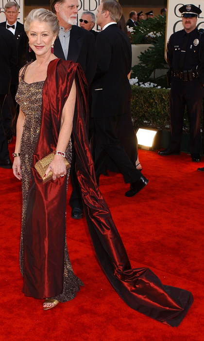 Dame Helen Mirren was the epitome of glamour in a sparkling gold gown paired with a dramatic red satin wrap draped over one shoulder in 2002. (Photo by Gregg DeGuire/WireImage)