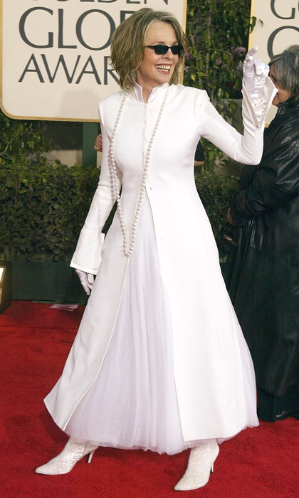 Meanwhile, Diane Keaton had some fun on the red carpet in an all-white, Willy Wonka-inspired outfit. The kooky actress accessorized the look with a pair of white satin gloves, a long single strand of pearls and sunglasses. (Photo by Carlo Allegri/Getty Images)