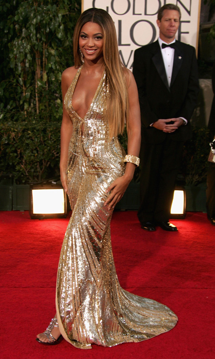 Beyoncé dazzled in a hip-hugging sequinned gold Elie Saab gown with daring décolletage in 2007. (Photo by Frazer Harrison/Getty Images)