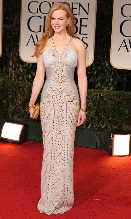 A regal Nicole Kidman showed off her incredible figure in a grey-and-gold Versace gown in 2012. (Photo by Steve Granitz/WireImage)