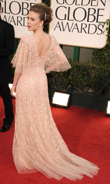 Screen siren Scarlett Johansson opted for a softer red-carpet look than we're used to seeing on the actress in 2011, winning major style points by donning a blush-coloured beaded Elie Saab gown with an elegant updo. (Photo by Steve Granitz/WireImage)