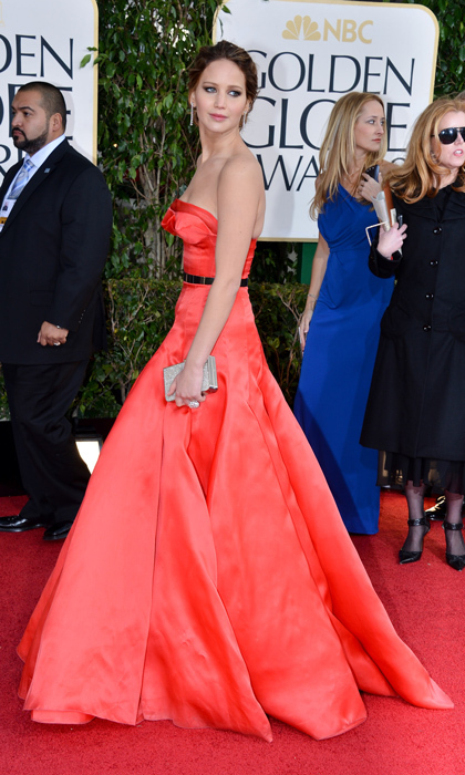 Jennifer Lawrence picked up her first Golden Globe for Best Actress in a stunning red Christian Dior dress with a metallic belt at the 2013 awards show.(Photo by George Pimentel/WireImage)
