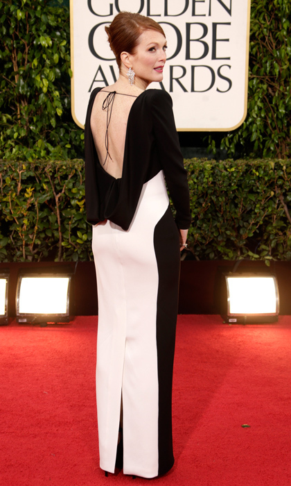 For the 2013 Golden Globes, Julianne turned to her favourite designer – Tom Ford – and e-mailed him personally asking if he would make her something special to wear. Mr. Ford delivered on his promise with a beautiful black-and-white backless dress. (Photo by Jeff Vespa/WireImage)