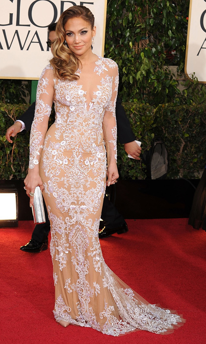 All eyes were on Jennifer Lopez – and her incredible curves! – in this peek-a-boo white lace Zuhair Murad gown. (Photo by Steve Granitz/WireImage)