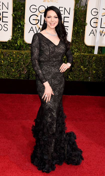 'Orange is the New Black' star Laura Prepon donned a lacy black Christian Siriano gown with a feathered train paired with oodles of diamond jewelry. 