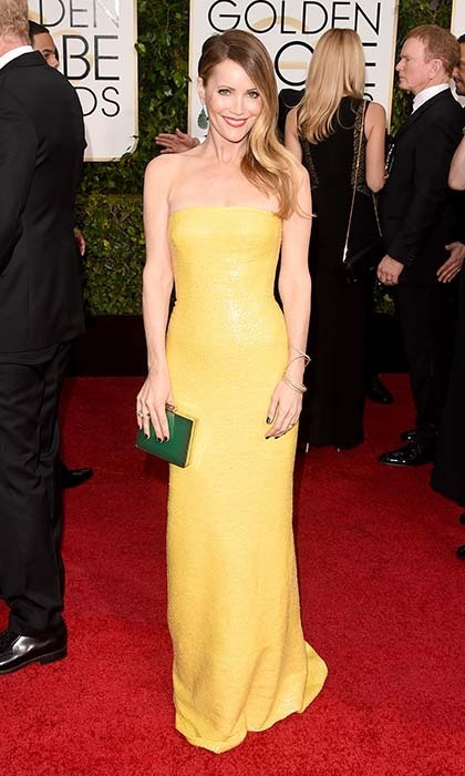 Do we spot a trend? Leslie Mann shone bright in a strapless yellow KaufmanFranco gown paired with jade-green accessories. 