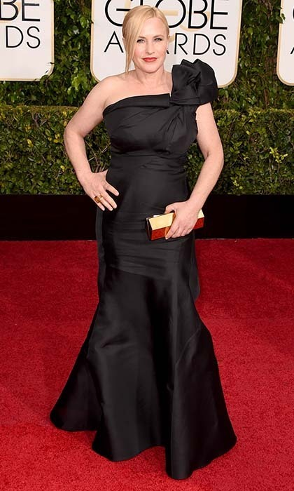 Patricia Arquette was elegant in custom Escada - a black one-shouldered gown with a bow detail. 