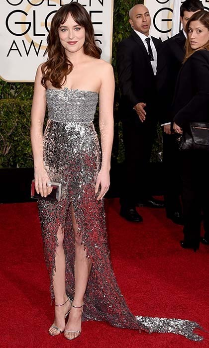 Dakota Johnson sparkled in a sequinned silver Chanel number with a daring slit. 
