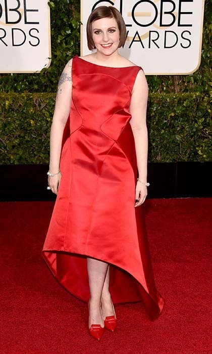 Lena Dunham once again donned a vibrant Zac Posen number, but this time in radiant red. 