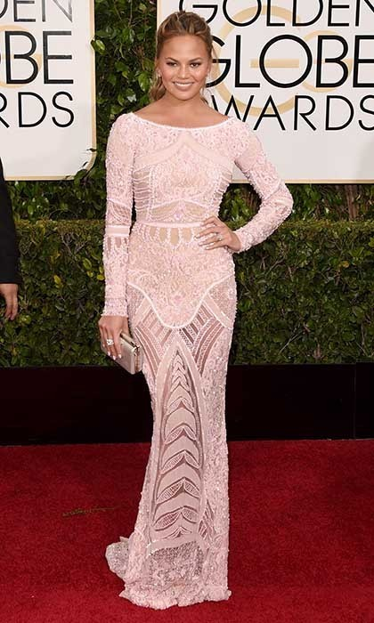 Chrissy Teigen was stunning in a body-skimming pink Zuhair Murad gown with all-over beaded detailing. 