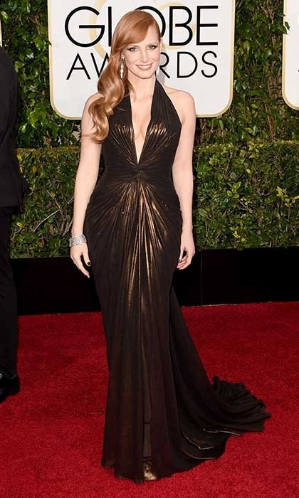 "Though Jessica Chastain oozed sex appeal in this slinky Versace number, the stunning starlet nonetheless revealed that she was nervous. ""The red carpet is not something I look forward to. Right now I'm thinking, 'I'm going to be the one who is going to fall backwards!' 