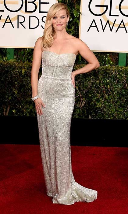 Reese Witherspoon looked every inch the Hollywood glamazon in a strapless metallic Calvin Klein dress. 