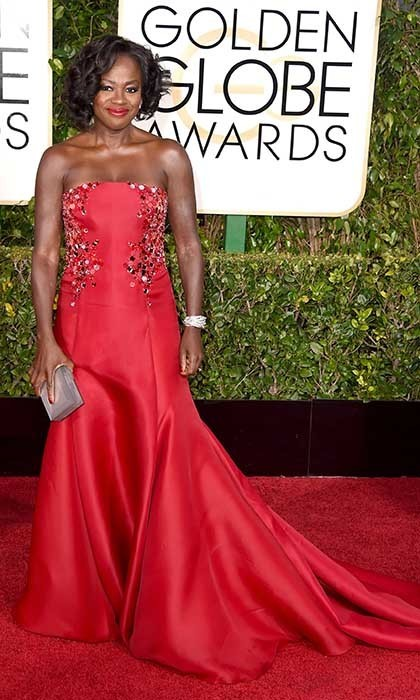 Viola Davis was flawless in a strapless red gown  by Donna Karan Atelier and cherry-red lipstick to match. 