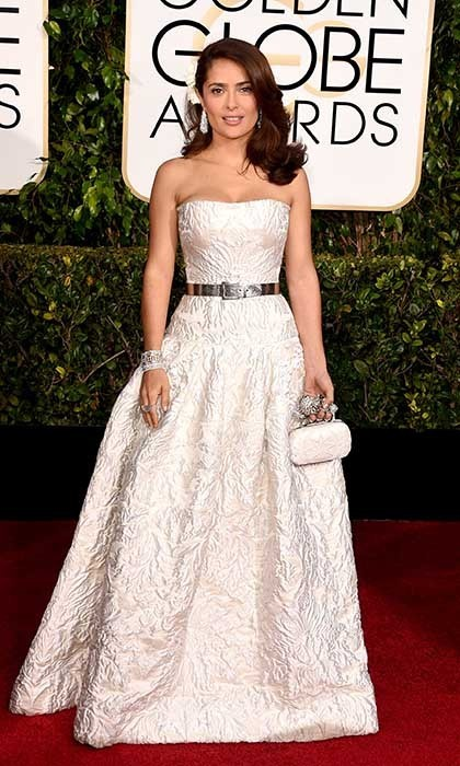 Salma Hayek stunned in a strapless white gown by Alexander McQueen. She accessorized with a white flower in her hair. 