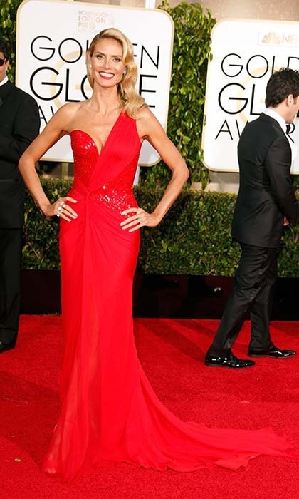 Heidi Klum brought her fashion A-game as usual in a beautiful red one-shouldered Versace gown. 