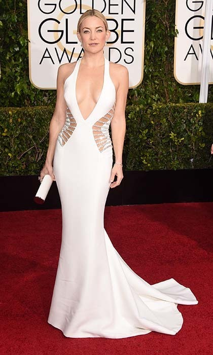 Kate Hudson showed some skin in a plunging white Versace dress with Swaorvski crystal-encrusted cutouts. 