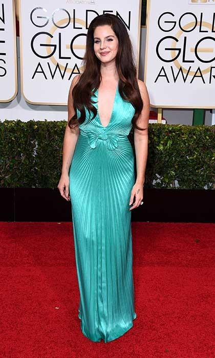 Lana del Rey wore a mermaid-inspired, turquoise Travilla gown. 