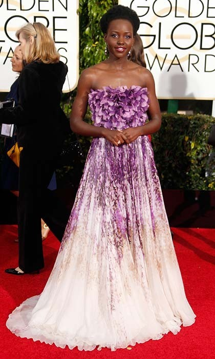 "Lupita Nyong'o was anything but ordinary in a colourful purple-and-white Giambattista Valli dress. ""Now the pressure is off!"" she said of choosing her gown this year. 