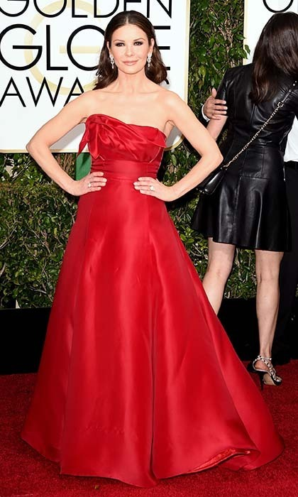 Catherine Zeta-Jones rocked the red carpet in a glamorous red satin number. 