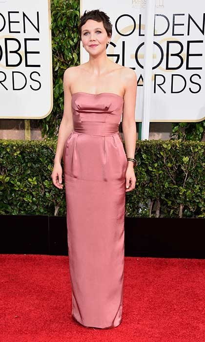 Maggie Gyllenhaal was elegant in a strapless blush-coloured Miu Miu column gown.