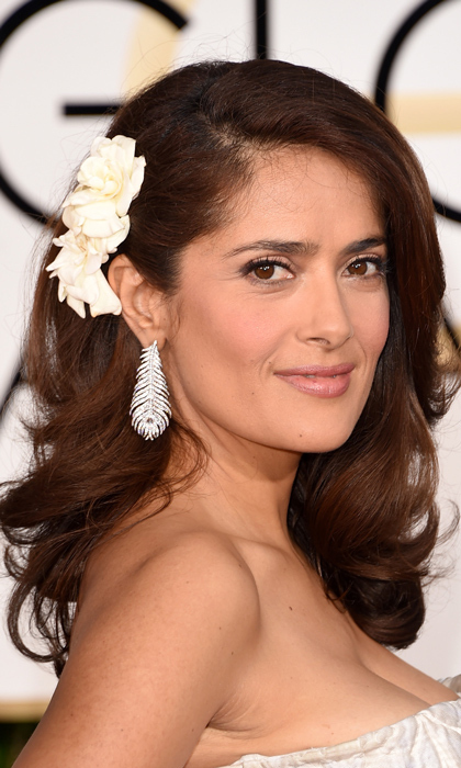 Salma Hayek's feather diamond earrings were courtesy of Boucheron, and the actress completed her look with a floral headpiece. (Photo: Getty)