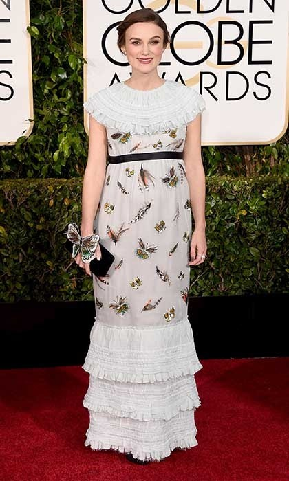 Mom-to-be Keira Knightley donned a whimsical, butterfly-accented gown by Chanel. (Photo: Getty)