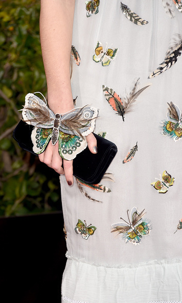 And, on closer inspection, she wore the biggest butterfly of all on her hand. So pretty! (Photo: Getty)