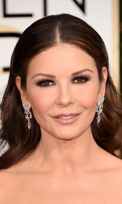 Presenter Catherine Zeta-Jones wore an intriguing pair of abstract floral earrings. (Photo: Getty)