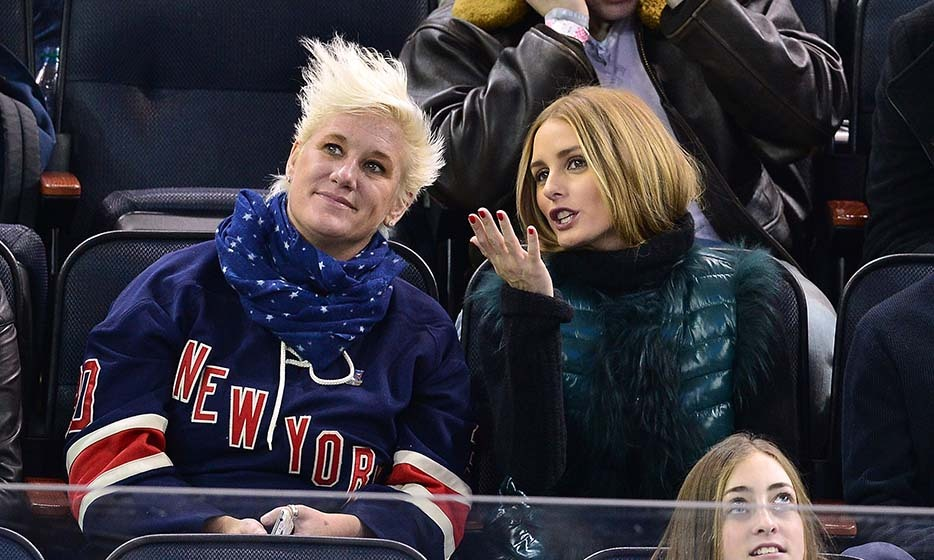 While chef and TV personality Anne Burrell showed her team spirit as the New York Rangers took on the Carolina Hurricanes in December 2014, Olivia Palermo opted for a teal, fur-lined vest. (Photo by James Devaney/GC Images)