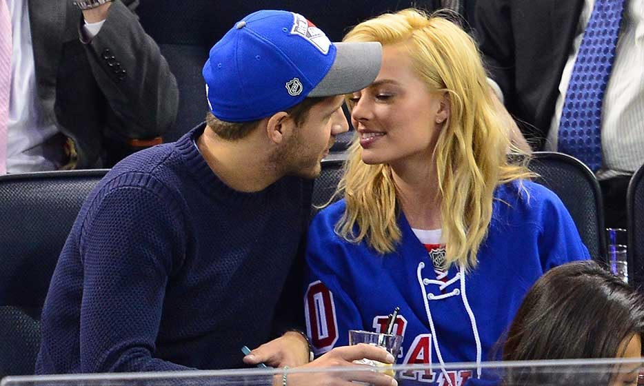 NHL? More like PDA! Actress Margot Robbie and assistant director Tom Ackerley showed that their love of the New York Rangers (who were taking on the Philly Flyers) is surpassed by their love for each other. (Photo by James Devaney/GC Images)