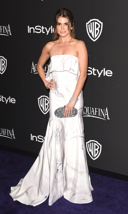 Newly engaged actress Nikki Reed turned heads in a strapless Katharine Kidd gown featuring a grey watercolour print and mermaid hem, and accessorized with Anita Ko jewelry and a marble Edie Parker clutch.