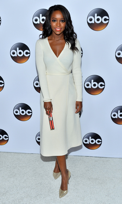 'How to Get Away with Murder' star Aja Naomi King stepped out at ABC's TCA press event in a ribbed off-white wrap dress and shimmering gold pumps.