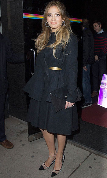 Looking chic in a black peplum coat for The Wendy Williams show.
