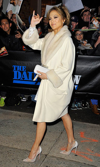 Looking elegant in a cream coat and matching high heels for The Daily Show with Jon Stewart.