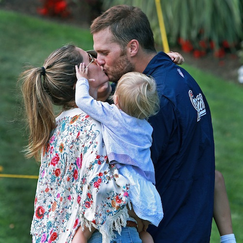 New England Patriots champ Tom Brady stole a kiss from supermodel wife Gisele Bundchen who he wed in 2009. The couple have a son Ben, 5, and daughter Vivian, 2. Tom also is a loving father to his son John, 7, he had with Bridget Moynahan.