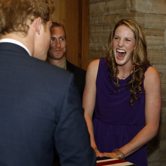 Olympic gold medalist Missy Franklin looked overly pleased to greet Prince Harry in 2013.