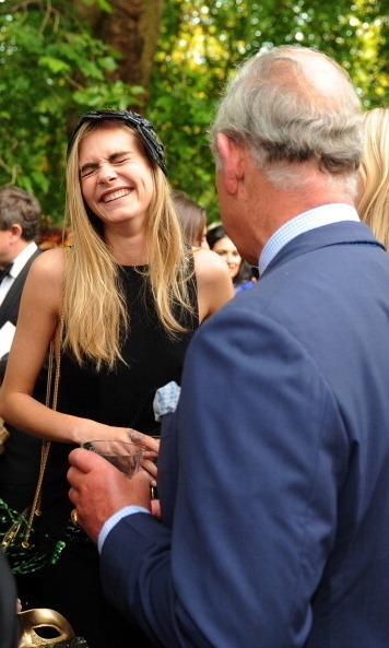 At the same event, Cara was her adorably goofy self while chatting with Prince Charles.