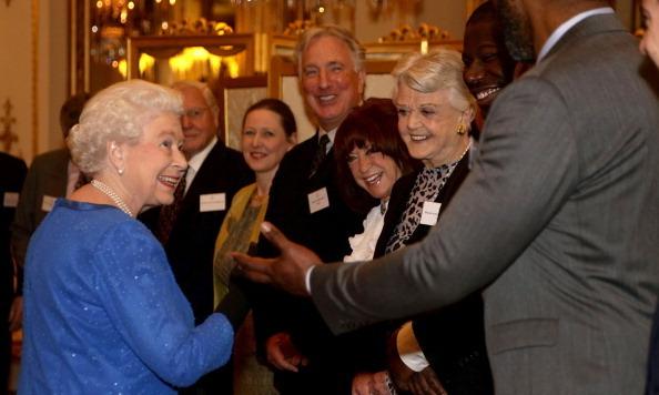 A well heeled group including Alan Rickman and Angela Lansbury basked in the Queen's regal glow during a Dramatic Arts reception at Buckingham Palace circa February 2014.