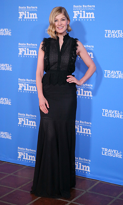 New mom Rosamund Pike attended the Santa Barbara Film Festival in a Victorian-inspired column gown by Canadian designer and recent CAFA winner Erdem.