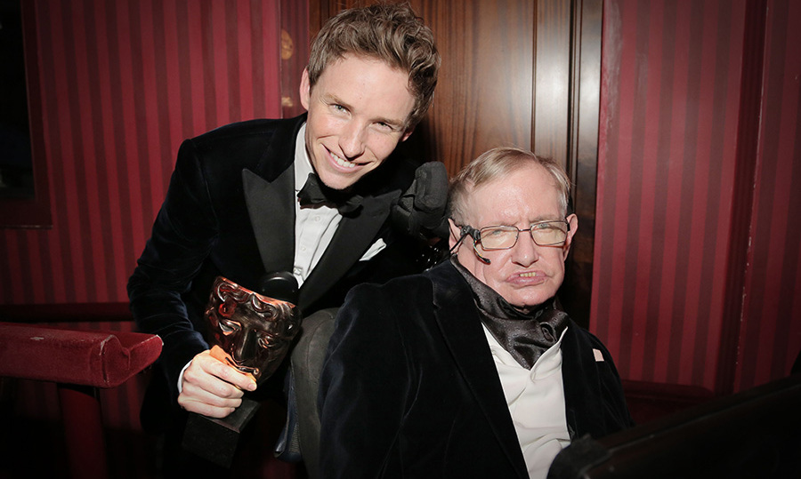 "Eddie Redmayne celebrated with Stephen Hawking following his Leading Actor win after thanking the professor and his ""incredible family"" in his acceptance speech.