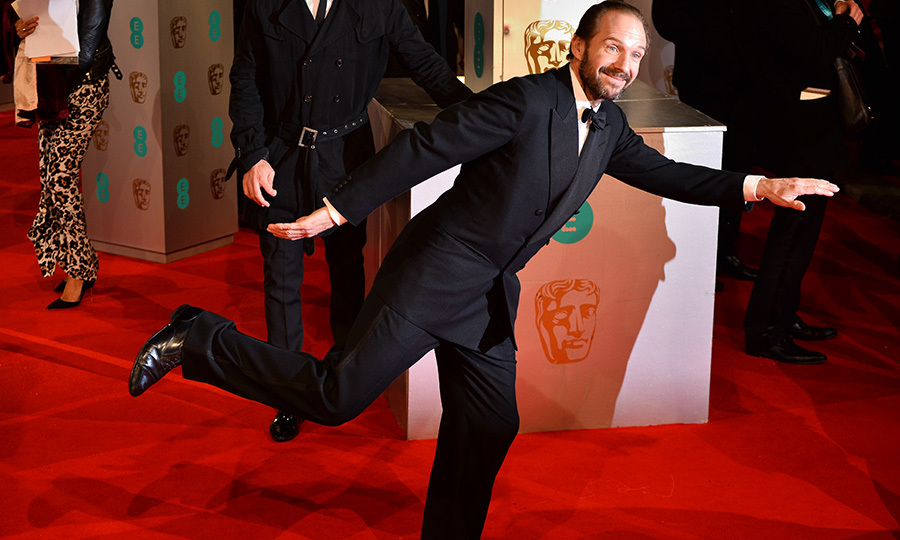 Ralph Fiennes had some fun on the red carpet, striking a pose for the awaiting crowds. The actor starred in The Grand Budapest Hotel, which took home five awards including Original Screenplay.