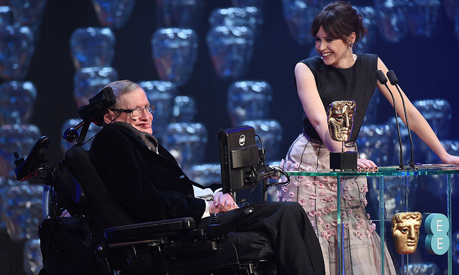 Professor Stephen Hawking received a standing ovation from the audience when he took to the stage with The Theory of Everything actress Felicity Jones.