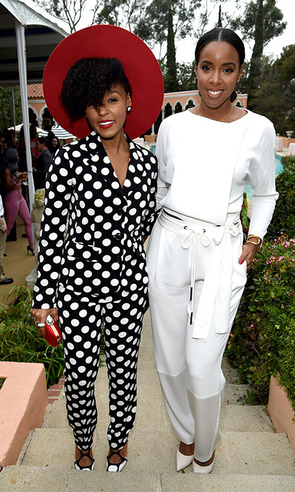 Songstresses Janelle Monae and Kelly Rowland were all smiles at Roc Nation's pre-GRAMMY party, where Janelle wowed in a bold polka-dot look by Moschino and Kelly donned a bright white two-piece ensemble.