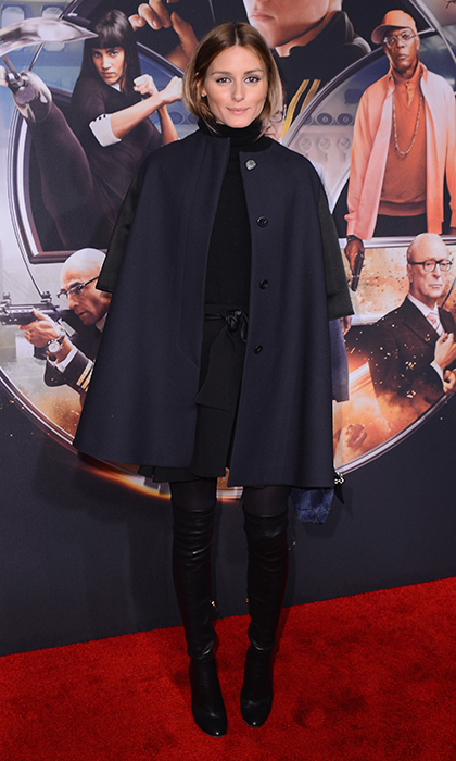 Olivia Palermo caught our eye at the 'Kingsman: The Secret Service' premiere in a navy cape, patent Stuart Weitzman boots and a Roger Vivier clutch.
