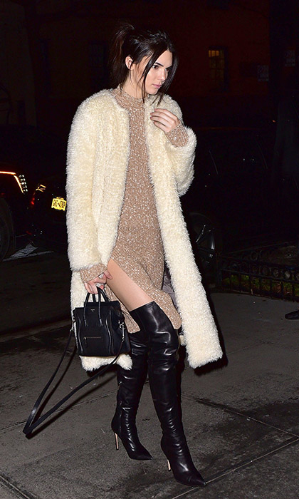 Kendall Jenner made her way to New York's Gramercy Park Hotel in a sleeveless Celine sweater dress and shearling Ashley B coat complemented by thigh-high leather boots and a mini Celine handbag.