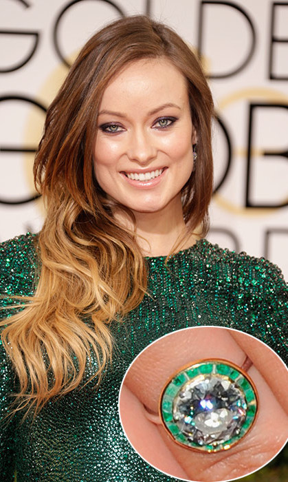 Bringing out the colour in her eyes, Olivia Wilde's engagement ring picked out by her funnyman love Jason Sudeikis was the perfect choice. The ring features a central diamond surrounded by a halo of tiny emeralds, which catch the light as Olivia moves her hand.
