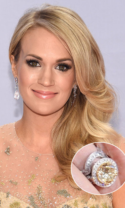 Bearing a similarity to Natalie Portman's ring, Carrie Underwood's sparkler also features a halo setting, with a circle of diamonds wrapped around a yellow-and-white 12-carat stone. The rock, created by Carrie's NHL player beau, Mike Fisher, with the help of the singer's favourite designer, Johnathon Arndt, is estimated to be worth $800,000. 