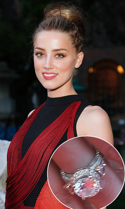 Amber Heard may not have spoken publicly about her engagement to Johnny Depp, but her huge diamond engagement ring did all the talking. Diamond experts have estimated the bauble to be a five-carat, oval diamond which could be valued at almost $100,000. 